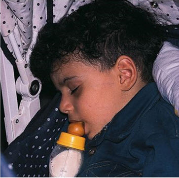 child-sleeping-with-bottle